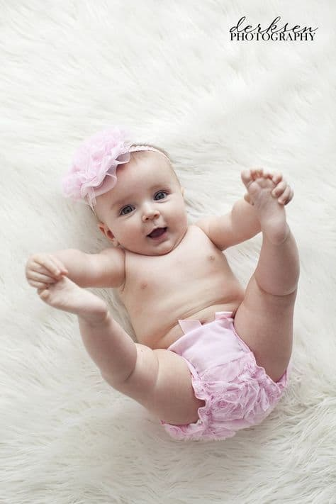 baby with pink ruffle diaper and matching head piece