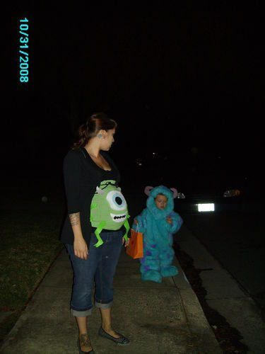 Pregnant woman dressed in a Monster's Inc costume