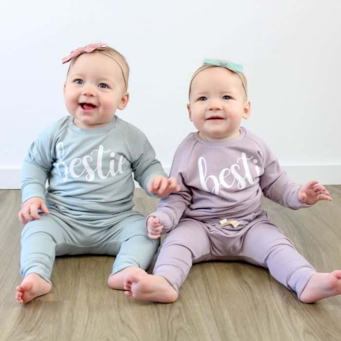 two babies wearing 'bestie' pajamas from Posh & Cozy