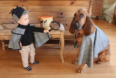 baby dressed as sherlock holmes with bloodhound