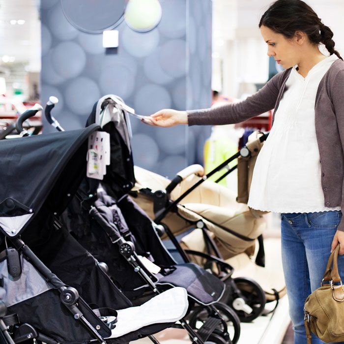 pregnant woman shopping for baby strollers from the stroller quiz