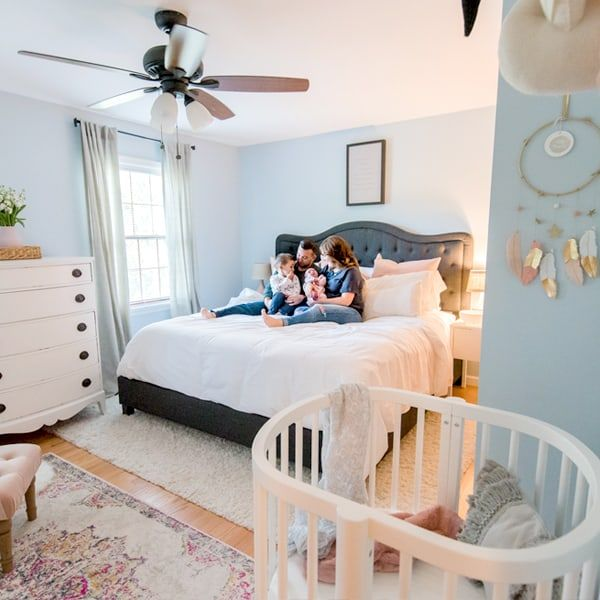 master bedroom with mini crib