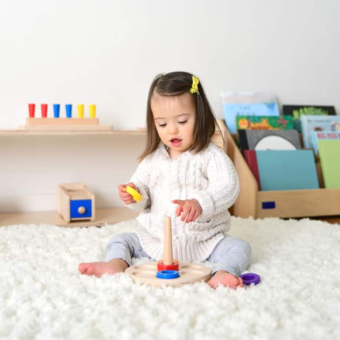 toddler playing with wooden toys