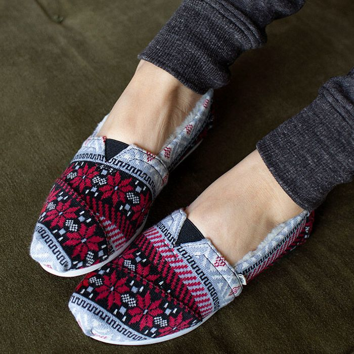 toms slippers on a pregnant person's feet