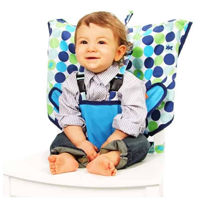 toddler sitting in portable high chair