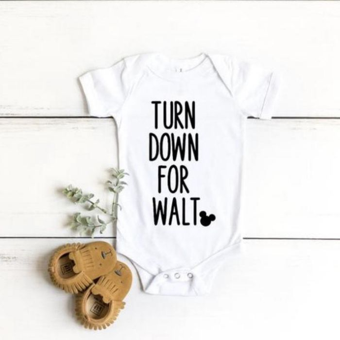 """White newborn onesie with black letters that say """"turn down for Walt"""""""