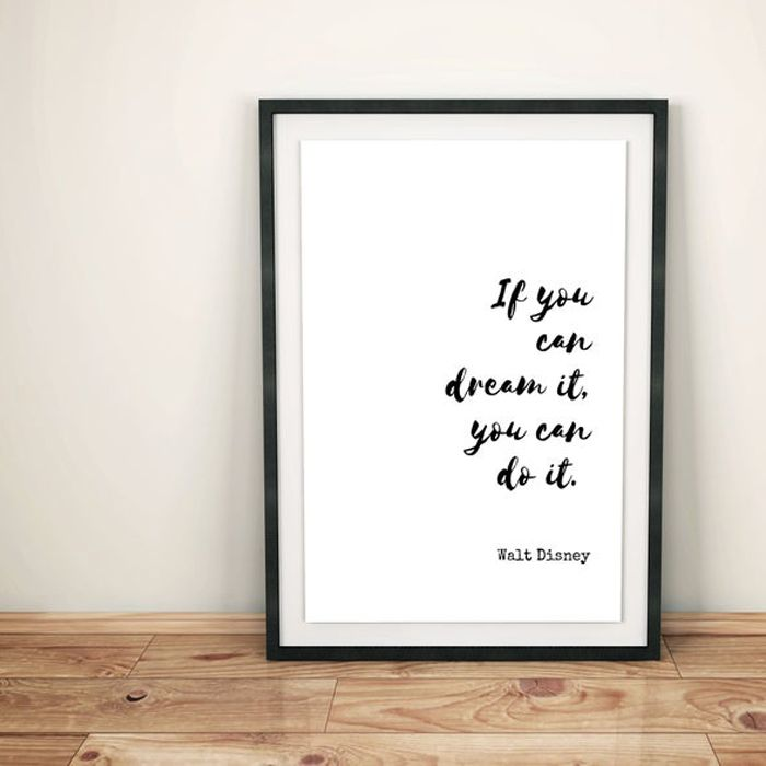 """White poster with black lettering that says, """"if you can dream it you can do it."""" Attributed to Walt Disney"""
