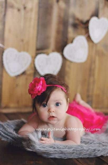 baby dressed in pink for Baby's First Valentine's Day Photo shoot