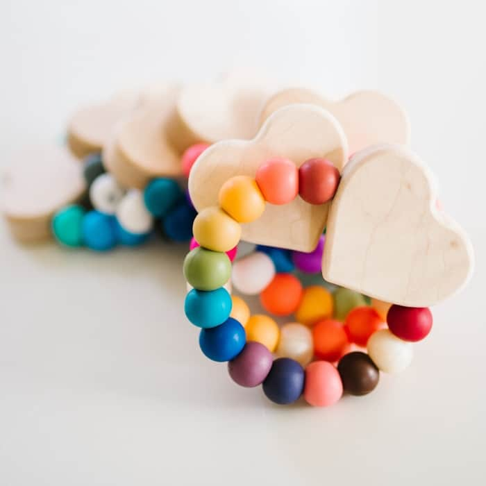 wooden heart teether with colorful beads - Baby's First Valentine's Day Gifts idea