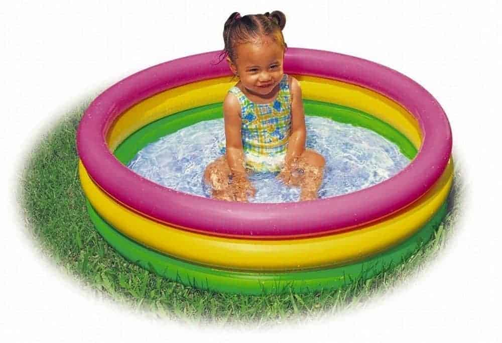 little girl sitting in inflatable pool