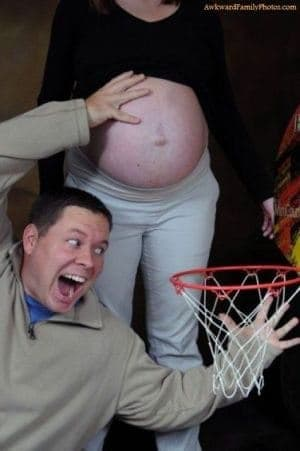 Man pretends to use pregnant woman's bare bump as a basketball