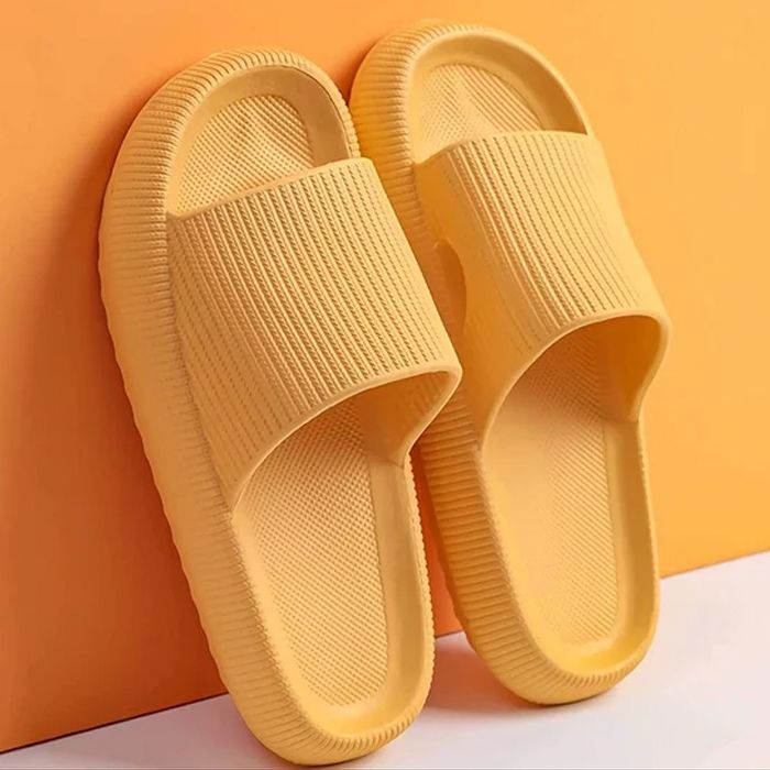 orange pillow slides leaning on a wall